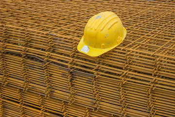 Stack of rebar grids with yellow helmet