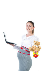 Beautiful pregnant businesswoman with notebook, bear toy and bea