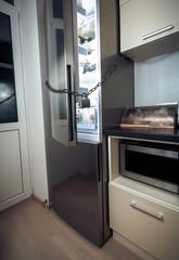 refrigerator on kitchen locked by chain