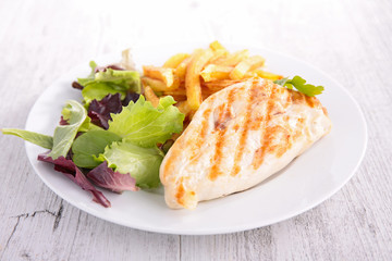 chicken breast with salad and fries