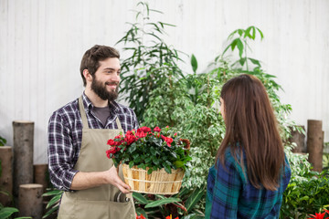 Young adult woman and worker at garden center