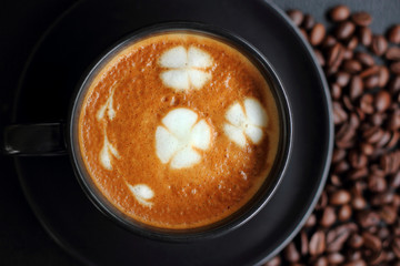 art coffee in black cup