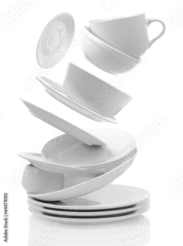 Leinwandbild Motiv Clean empty plates and cups isolated on white
