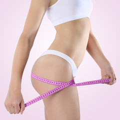 body of woman with diet meter, Isolated on pink background