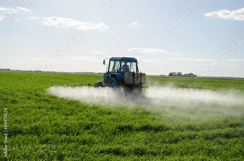 Tractor spray fertilize field pesticide chemical - 64479626