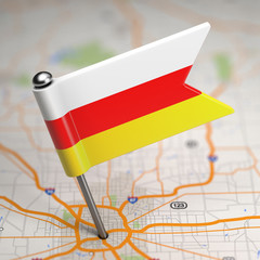 South Ossetia Small Flag on a Map Background.