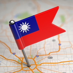 Taiwan Small Flag on a Map Background.