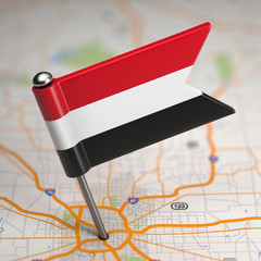 Yemen Small Flag on a Map Background.