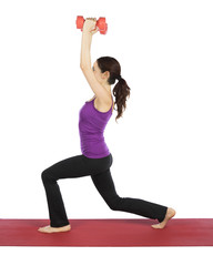 Young fitness woman doing lunge with weights