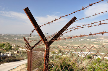 Barbed wire fence protecting israeli settlement.