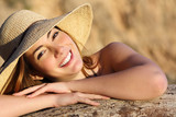 Fototapety Portrait of a happy woman smiling with perfect white smile