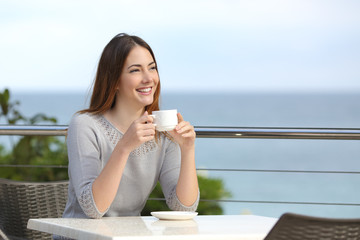 Beautiful woman holding a cup of coffee in a restaurant