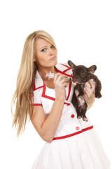 nurse with small dog sad giving shot