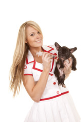 nurse with small dog smile giving shot