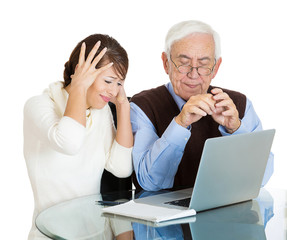 Technology generation gap girl teaching old man to use computer