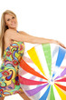 woman colorful dress holding onto large ball