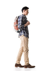 Side view of young Asian backpacker
