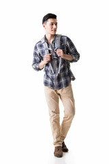 Asian young traveling man walking