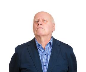 Headshot annoyed grumpy suspicious old man white background