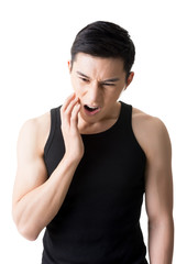 Young Asian man with toothache