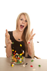 woman eating jelly beans and throwing them