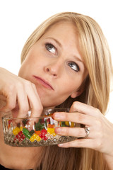 woman eating jellybeans look up