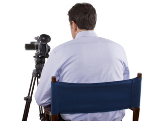 casting director sitting and recording auditions with camera