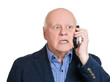 Bad news phone call. Senior man has unpleasant conversation