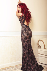 beautiful woman with red hair  in elegant  lace dress