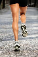 Female Runner on Gravel Road