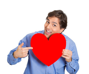man pointing at a large heart reminds about compassion