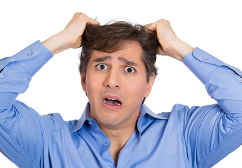 Stressed, frustrated business man pulling out his hair