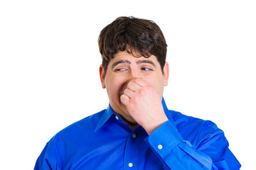 Man pinching his nose, bad smell, odor, situation