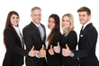 Confident Businesspeople Showing Thumbs Up