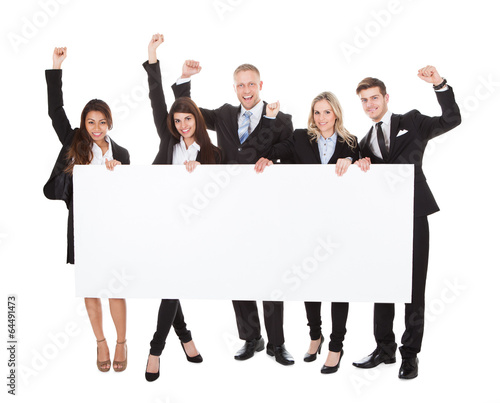 Confident Businesspeople Holding Blank Banner