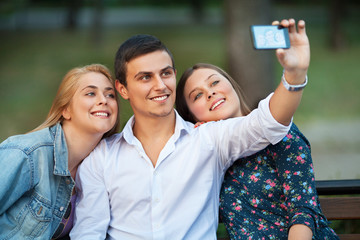 Group of young friends taking a photo of themselves