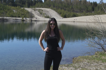 Satisfied woman by a beautiful lake (summer, trip, hike)