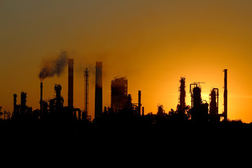 silhouette of ibig oil refinery factory  during sunset
