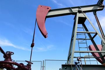 crude oil  jack pump under blue sky in europe