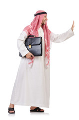 Arab businessman  with briefcase  pushing away virtual obstacle