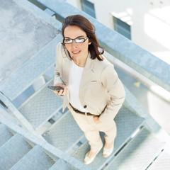 Portrait of a confident businesswoman using smart phone.