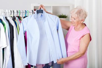 Elderly woman choosing an outfit