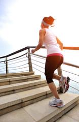 legs running at seaside stone stairs