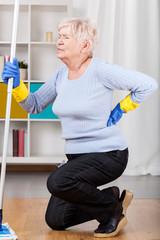 Elderly woman having back pain