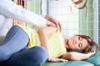 Physiotherapist massaging patient's arm