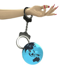 Asian earth globe attached with chain to human hand