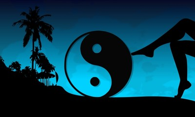 ying yang sign on a beach