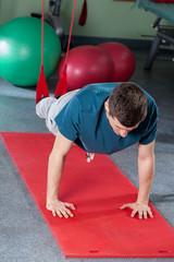 Man exercising in suspension