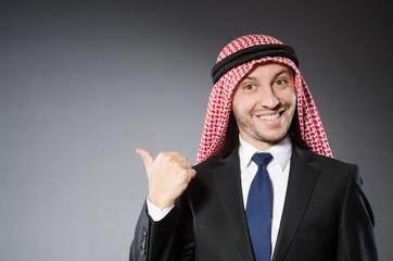 Arab businessman in delight against grey background
