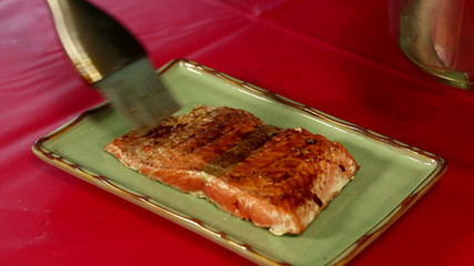 Bushing Sauce onto Salmon Fillet